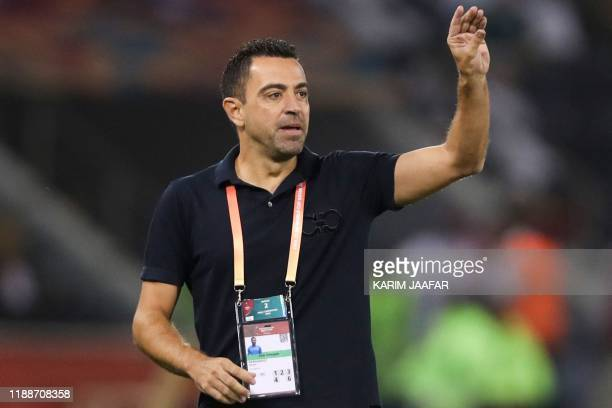 Sadd's coach Xavi speaks to his players during the 2019 FIFA Club World Cup quarter-final football match between Monterrey and al-Sadd at Jassim Bin...