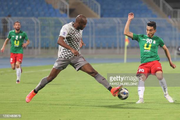 Sadd's defender Abdelkarim Hassan vies for the ball with Wehdat's midfielder Ahmed Samir during the AFC Champions League group D match between...