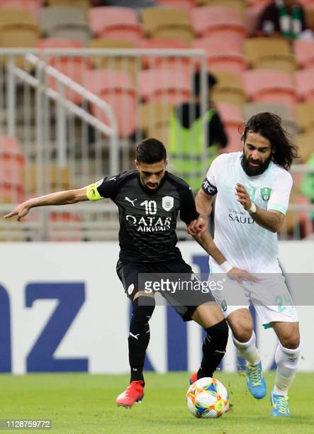 Sadd's midfielder Hassan AlHaidos is closed down by Ahli's Hussein Abdulghani during the AFC champions league Group D football match between Saudi...