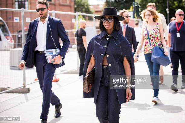 Sade Akinosho wearing a denim jacket and jeans is seen during the 94th Pitti Immagine Uomo at Fortezza Da Basso on June 14 2018 in Florence Italy