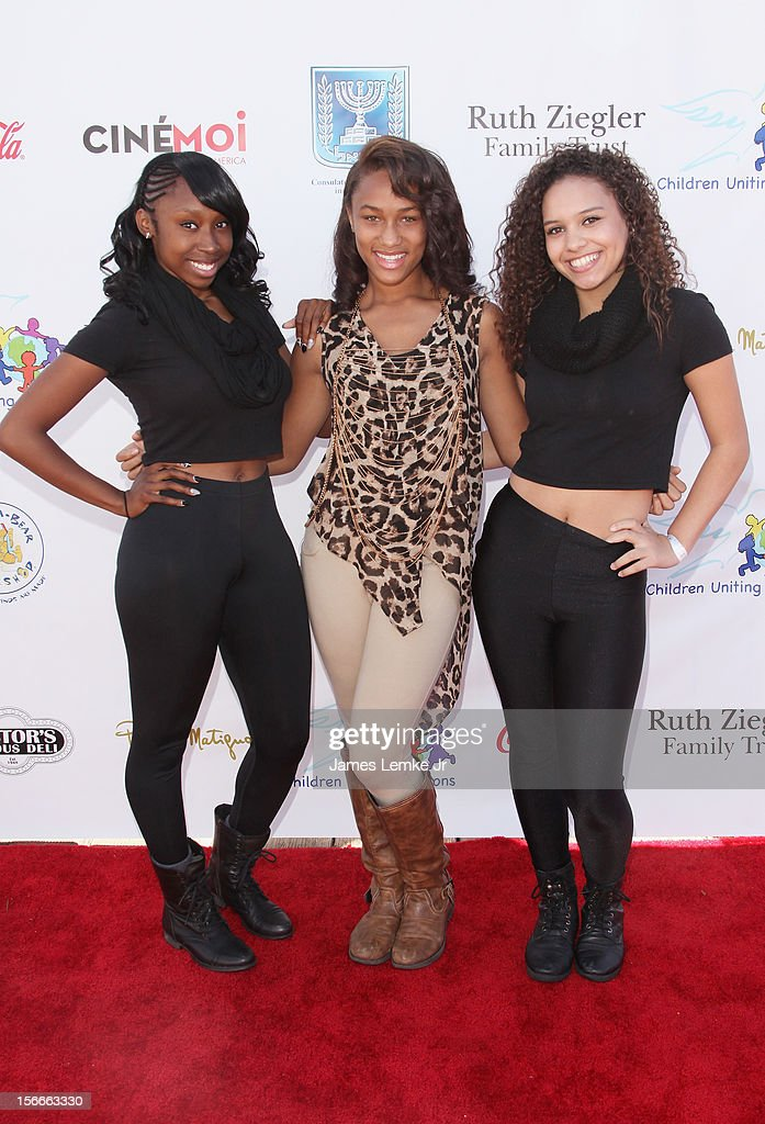 Sade Austin, Ammaya Calhoun and Justice Domined attend the Children Uniting Nations' Day of The Child Fundraiser held at the Santa Monica Pier on November 18, 2012 in Santa Monica, California.