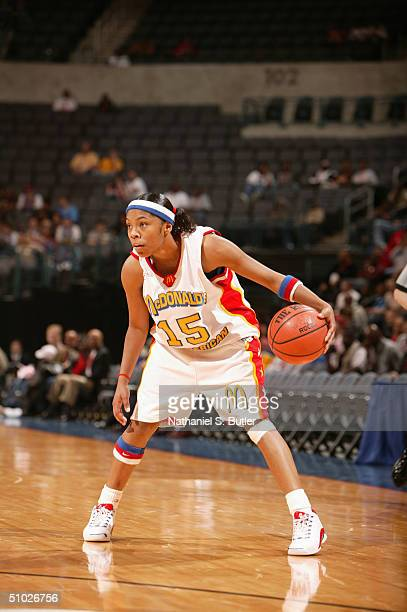 Sa'de WileyGatewood of the West Girls moves the ball against the East Girls during the 2004 McDonald's High School AllAmerican Game at Ford Center on...