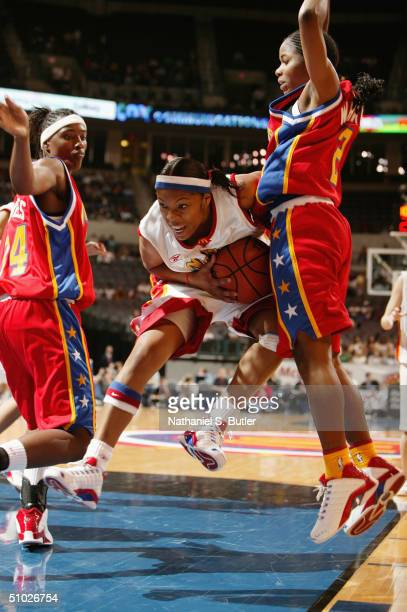 Sa'de WileyGatewood of the West Girls rebounds during the 2004 McDonald's High School AllAmerican Game against the East Girls at Ford Center on March...