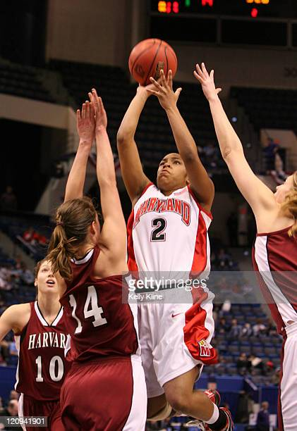 Sa'de WileyGatewood with the runner over Christiana Lackner of Harvard during the NCAA Women's Basketball Tournament first round matchup between the...