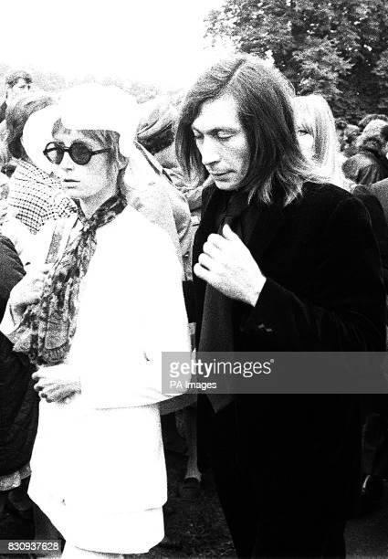 Sadfaced Charlie Watts of the Rolling Stones and his wife Shirley Watts stand at the graveside of Brian Jones former guitarist with the group whose...