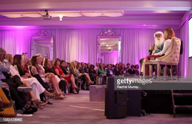 Sadhguru and Visionary Women's Executive Board Member Angella Nazarian speak onstage during Visionary Women Consciousness The Ultimate Intelligence...