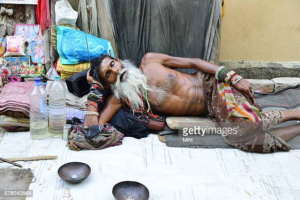 A sadhu at Assi Ghat on April 26 2016 in Varanasi India Summers in India are not for the fainthearted During the afternoons the temperature in...