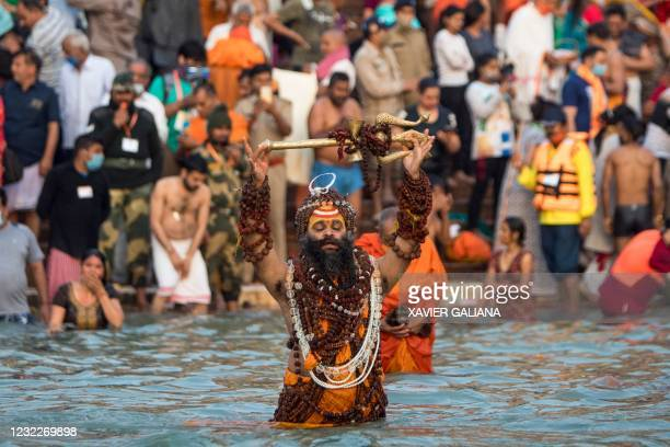 Sadhu bathes in the Ganges river during the ongoing religious Kumbh Mela festival in Haridwar on April 12, 2021.