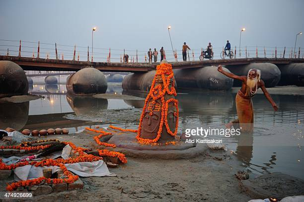 Sadhu dances to worship the Hindu gods at the Sangam the confluence of Yamuna Ganges and mythical Saraswati rivers during Maha Kumbh Mela