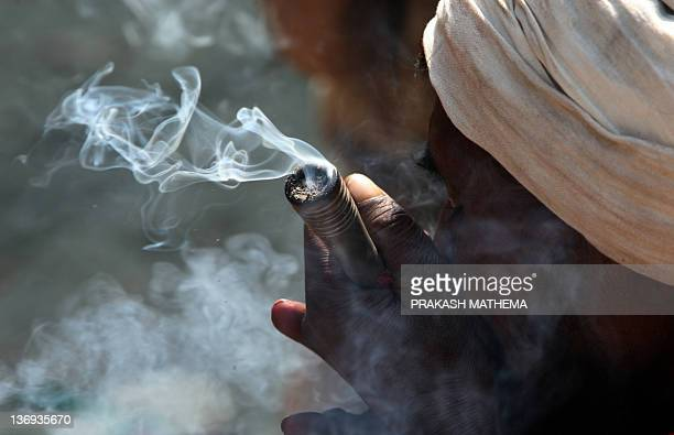 Smoking Chillum Stock Photos And Pictures