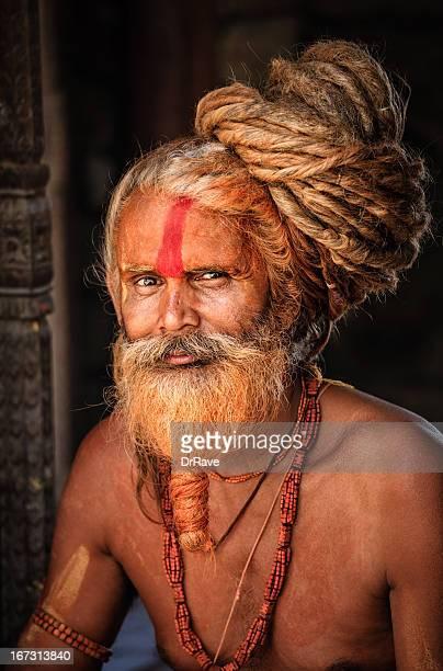 Sadhu - holy man with dreads looking at camera