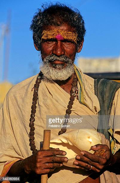 Sadhu in the holy city of Rameswaram He uses a conch for the offerings
