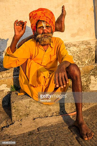 Sadhu - indian holyman practicing yoga in the temple