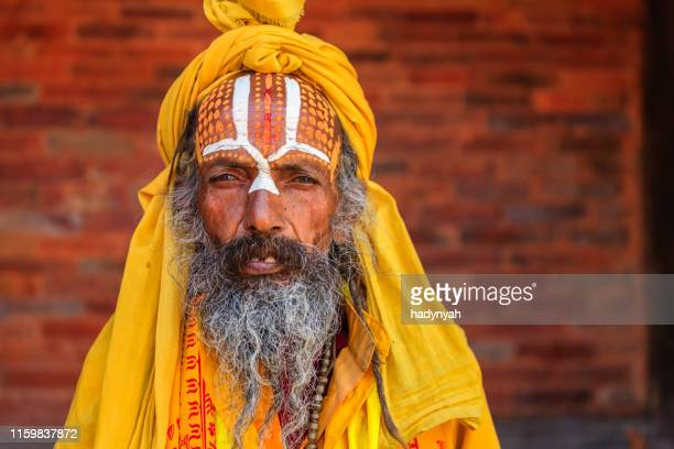 sadhu - indian holyman sitting in the temple - pashupatinath stock pictures, royalty-free photos & images