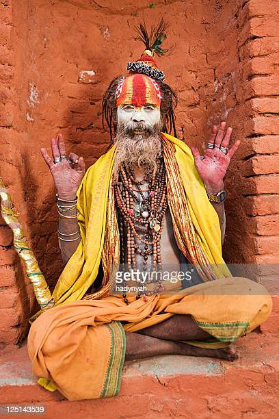 Sadhu - indian holyman sitting in the temple