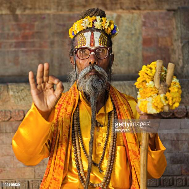 sadhu - indian holyman sitting in the temple - religious occupation stock pictures, royalty-free photos & images