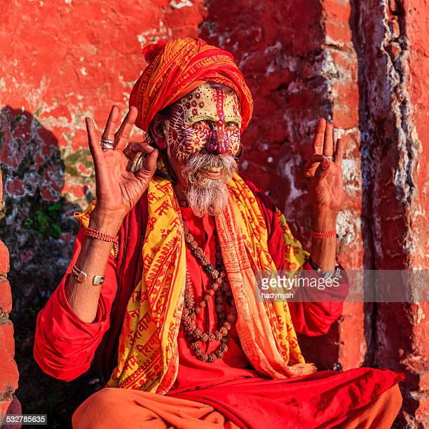 sadhu - indian holyman sitting in the temple - religious role stock photos and pictures