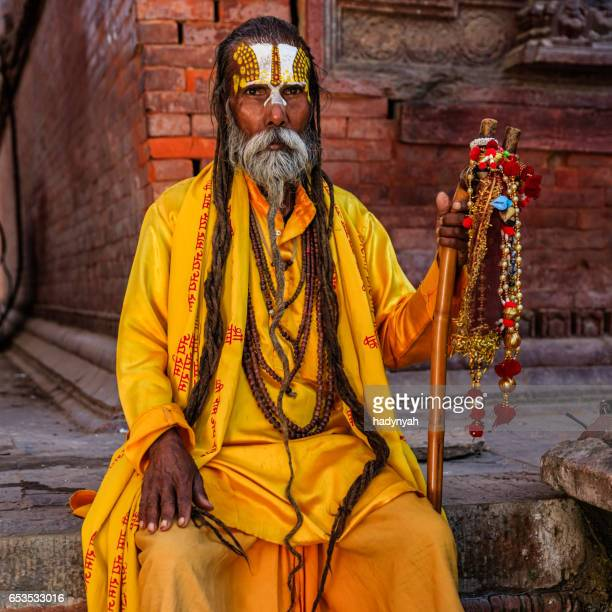 sadhu - indian holyman sitting in the temple - brahmin stock pictures, royalty-free photos & images