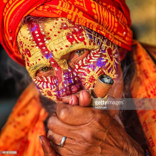 Sadhu - indian holyman smoking in the temple