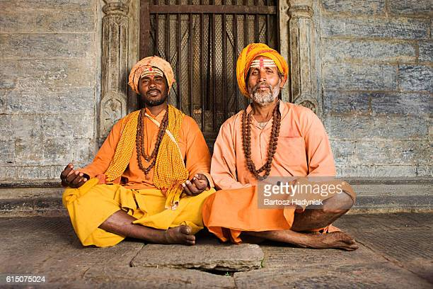 sadhu - indian holymen sitting in the temple - religious occupation stock pictures, royalty-free photos & images