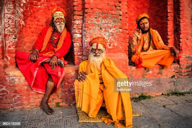 sadhu - indian holymen sitting in the temple - varanasi stock pictures, royalty-free photos & images