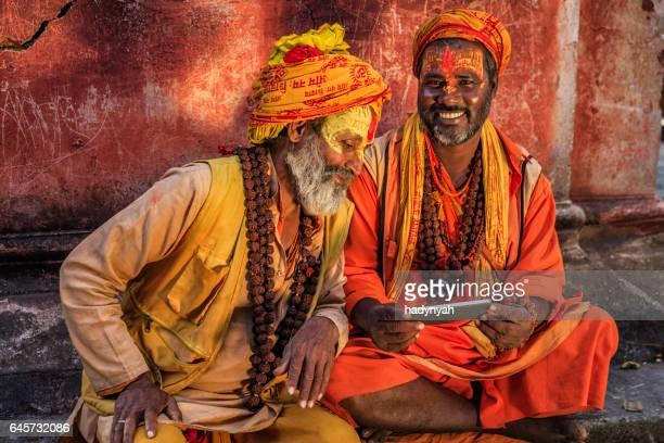 Sadhu - indian holymen using mobile phone