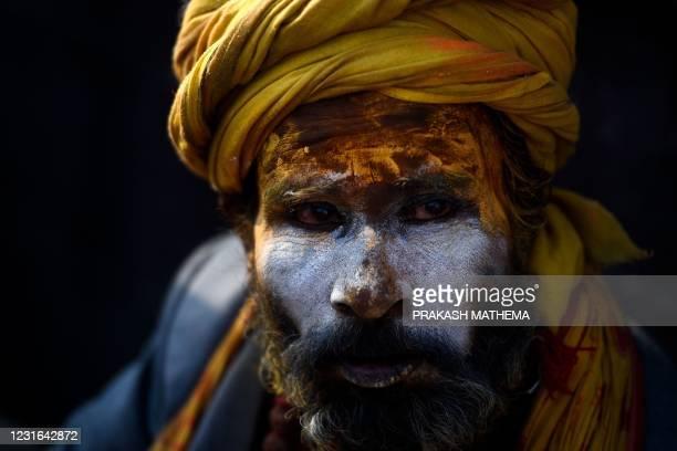 Sadhu looks on during 'Maha Shivaratri' festival, at Pashupatinath temple area in Kathmandu on March 11, 2021.