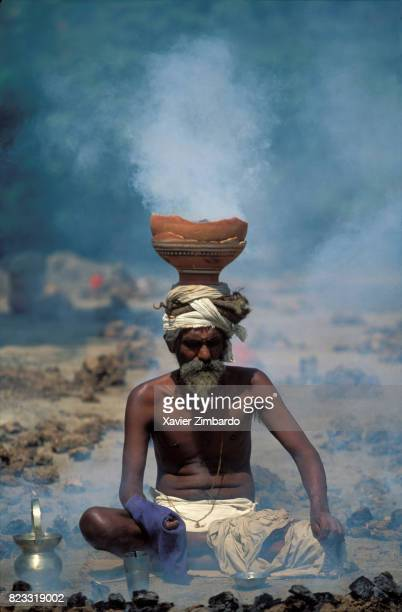 A sadhu meditates at the hottest hours of the day with embers in balance on his cranium during Maha Kumbh Mela on April 14 1998 in Haridwar...