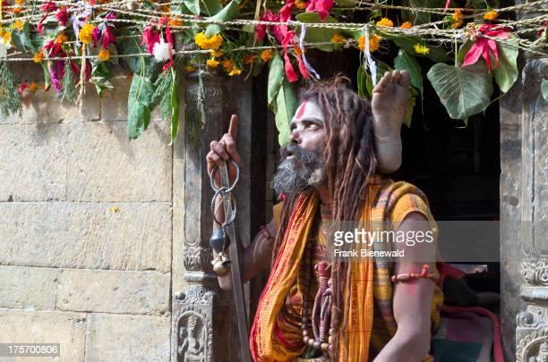 Sadhu, or Holy Man, practicing yoga opposite the burning ghats near Pashupatinath Temple..