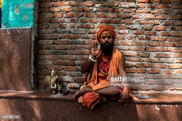 A sadhu poses for the camera in Parikrama Marg It is believed that sadhus have a divine soul