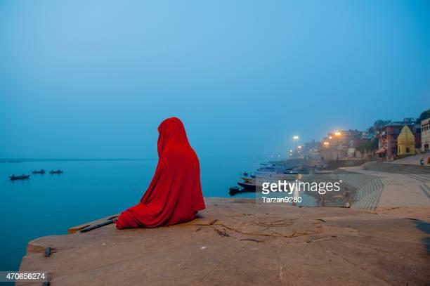 Sadhu sitting on the bank of Ganges River meditating