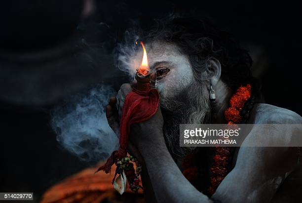 A Sadhu Smokes A Chillum A Traditional Clay Pipe As A Holy Offering To Lord Shiva
