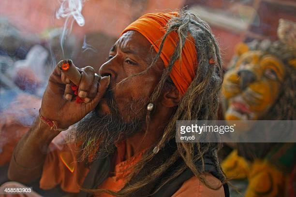 sadhu smokes - opium poppy stock pictures, royalty-free photos & images