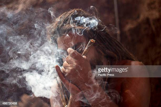 TRIMBAK NASIK MAHARASHTRA INDIA A sadhu smokes weed at Ramkund ghats A sadhu is a Holy man ascetic who leaves all worldly possessions and lives a...