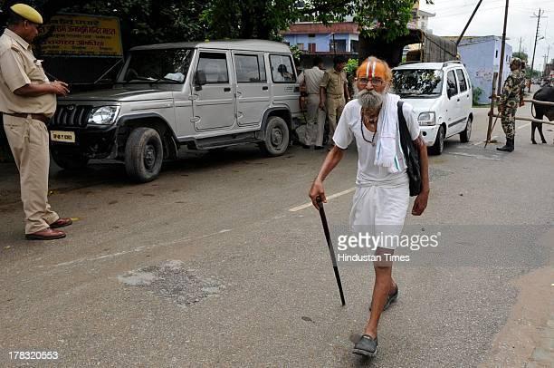 A sadhu walks amidst heavy security on August 28 2013 in Ayodhya India Three days after Vishwa Hindu Parishad field Parikarma attempt Ayodhya saw a...