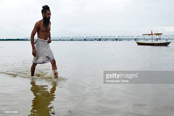 Sadhu walks at Saryu ghat after taking a holy dip on August 28, 2013 in Ayodhya, India. Three days after Vishwa Hindu Parishad field Parikarma...