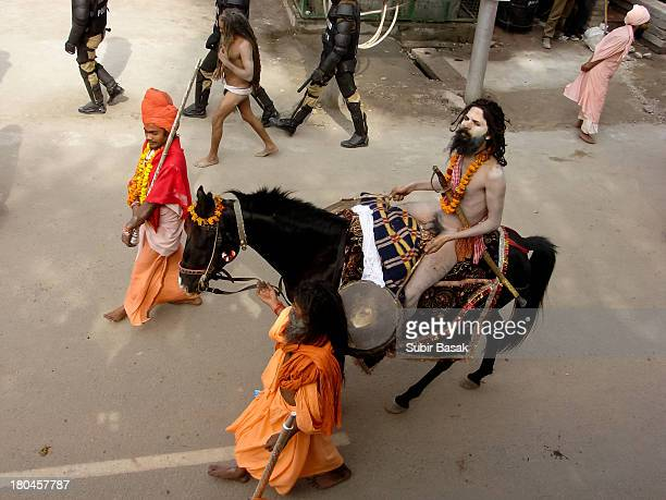 Sadhu/holy man riding a horse while he and others like him marched towards the Ganges river during the Kumbh Mela in Haridwar on February 14 2010...