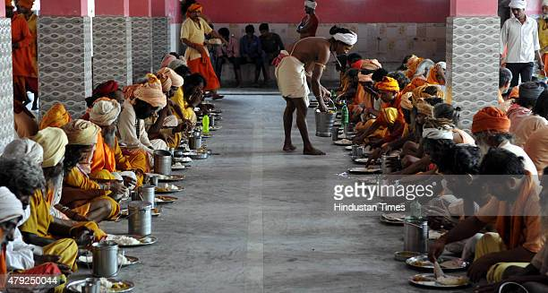 Sadhus eating meals at Ram temple as they wait for their registration for a pilgrimage to the Hindu holy site of Amarnath on July 2 2015 in Jammu...