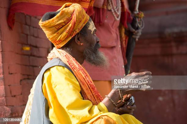 sadhus - holy men - queensland umbrella tree stock pictures, royalty-free photos & images
