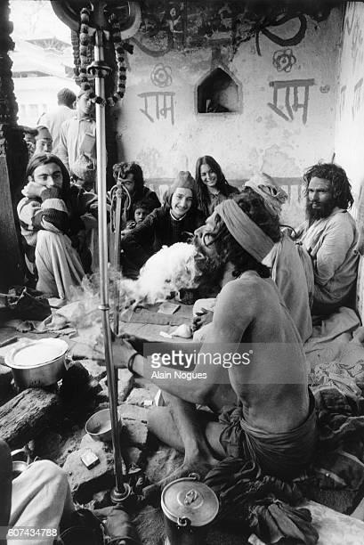 Sadhus or ascetics smoke hashish with hippies in Kathmandu