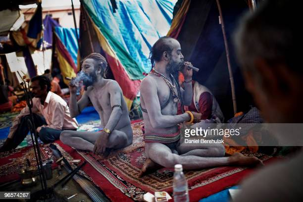 Sadhus or Hindu Holy Men smoke hashish in a camp near the banks of the Ganges river on February 11 2010 in Haridwar India Hundreds of thousands of...