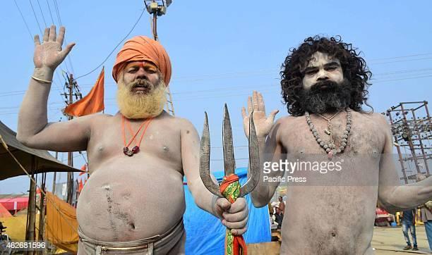 NAGA sadhus perform rituals at Sangam during Magh Mela festival