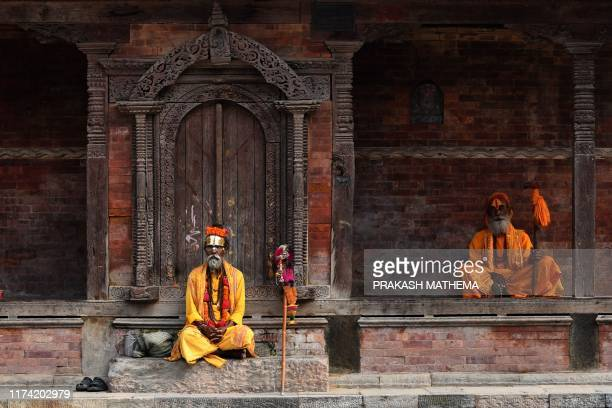 TOPSHOT Sadhus sit in the Hanuman Dhokha Durbar Square area of Kathmandu on October 7 2019