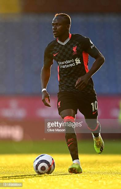 Sadia Mane of Liverpool in action during the Premier League match between Burnley and Liverpool at Turf Moor on May 19, 2021 in Burnley, England.