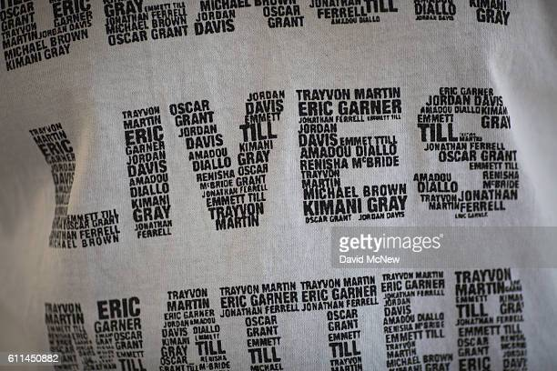 Sadic Ali Khalil wears a shirt bearing names of black people shot by police at the site where an unarmed black man Alfred Olango had been shot by...