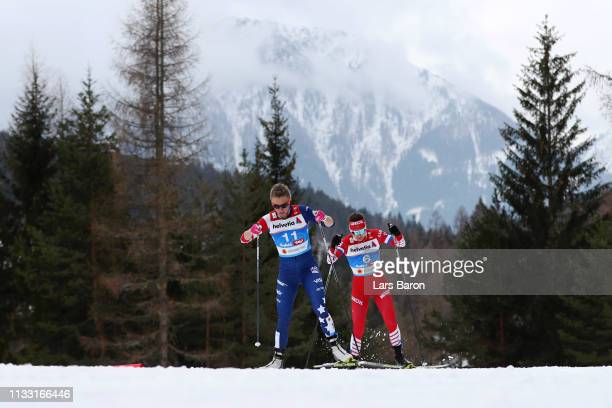 Sadie Bjornsen of the United States and Anastasia Sedova of Russia competes in the Women's Cross Country 30k race during the FIS Nordic World Ski...