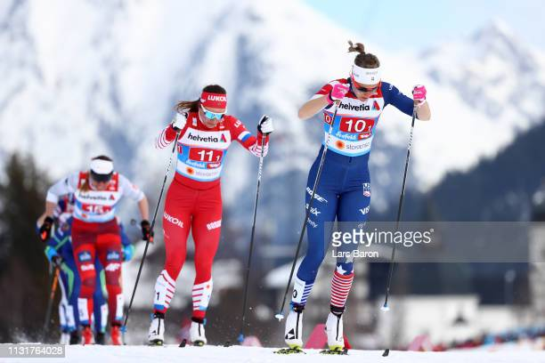 Sadie Bjornsen of the United States and Natalia Nepryaeva of Russia compete in the final for the Ladies' Cross Country Team Sprint during FIS Nordic...