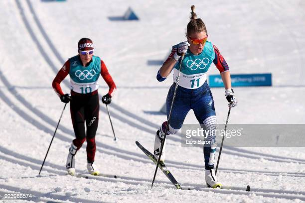 Sadie Bjornsen of the United States and Nathalie Von Siebenthal of Switzerland compete during the Ladies' 30km Mass Start Classic on day sixteen of...