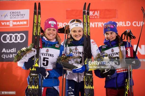 Sadie Bjornsen of USA Stina Nilsson of Sweden and Yulia Belorukova of Russia celebrates after the cross country sprint finals during the FIS World...