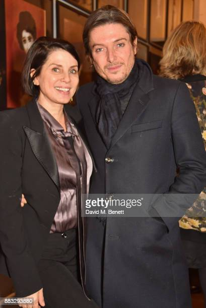 Sadie Frost and Darren Strowger attend a private view of artist Rebecca Leigh's exhibition hosted by Sadie Frost at Tann Rokka on November 30 2017 in...